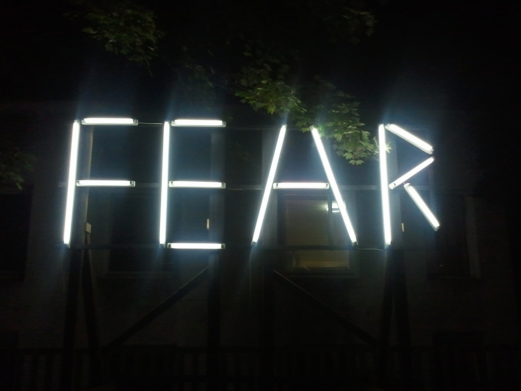 "Image of lights that spell out the word ""fear"""