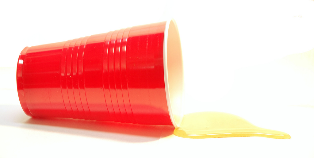 image of the iconic red drinking cup spilling alcohol.