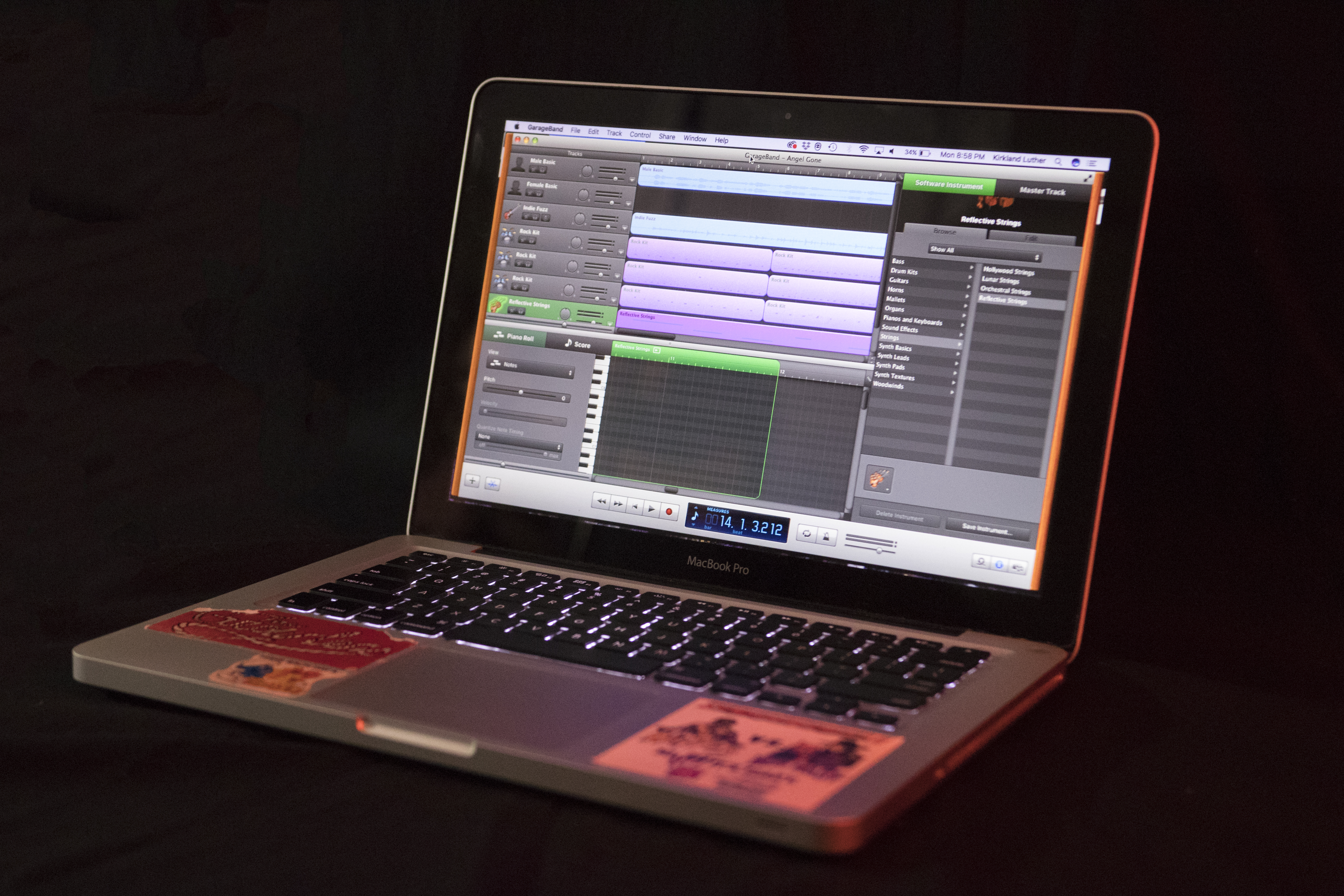 Open laptop showing music production software