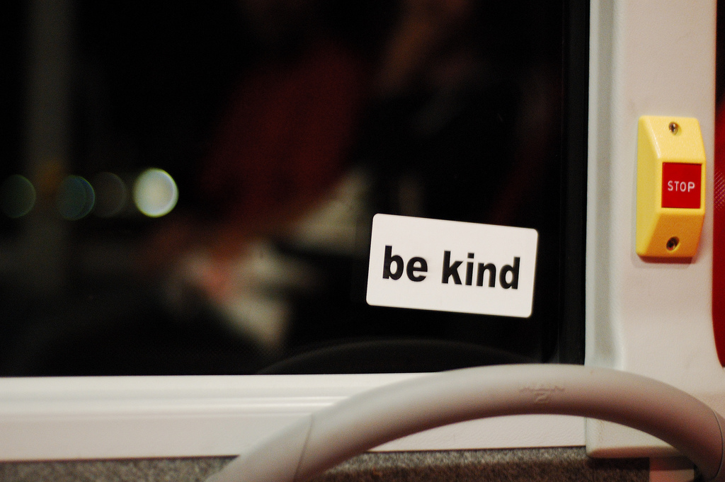 """Be Kind"" sticker on window"