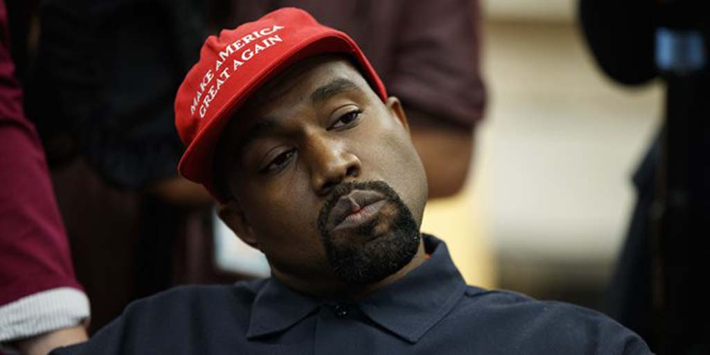 Kanye wearing his MAGA hat