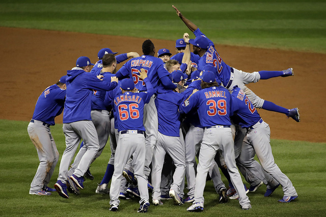 The Chicago Cubs celebrating after getting a win.