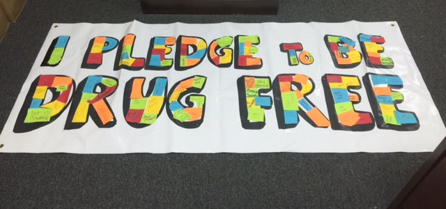 "Banner that says ""I Pledge to Be Drug Free"""