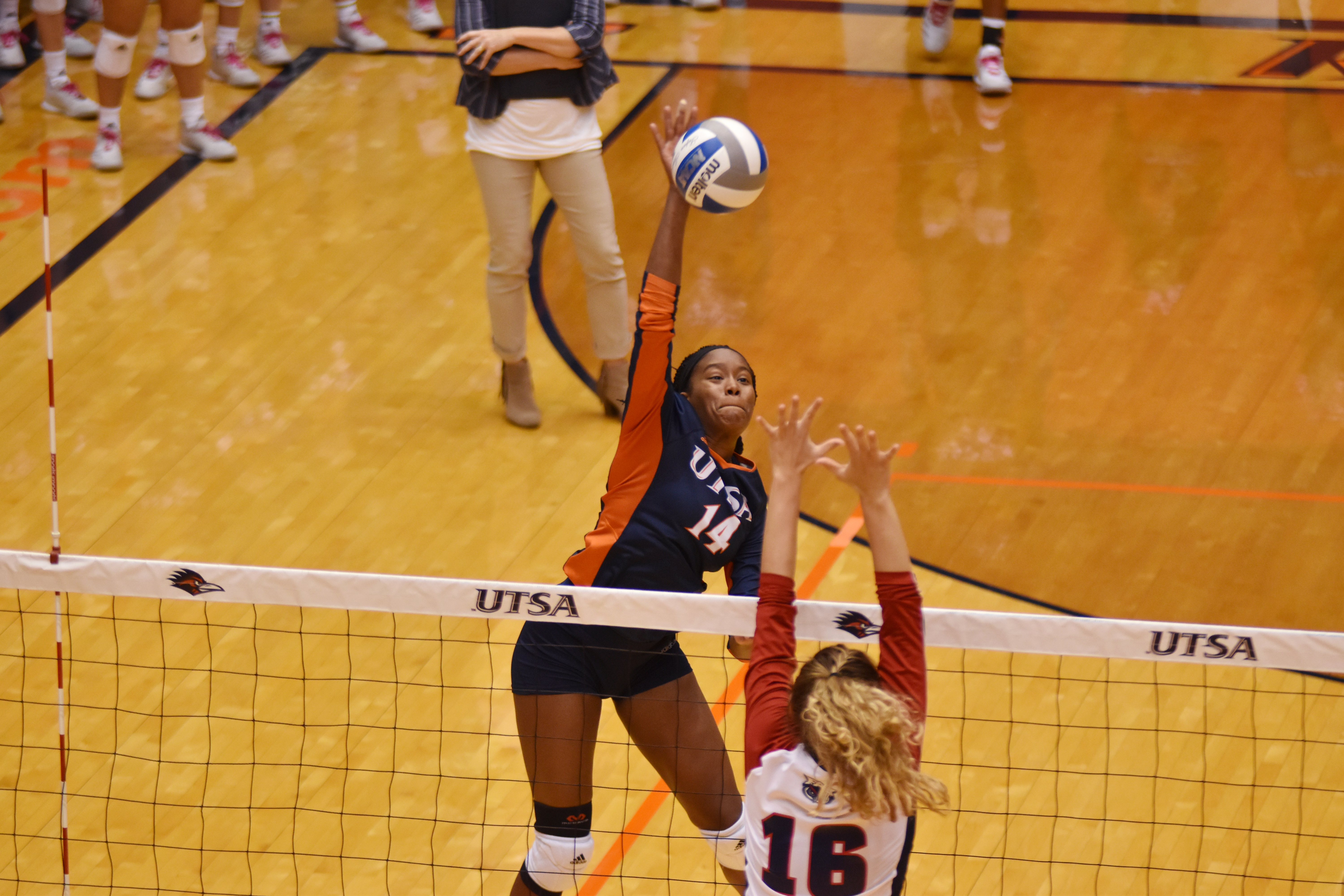 Brianna McCulloch spikes the ball over the net.