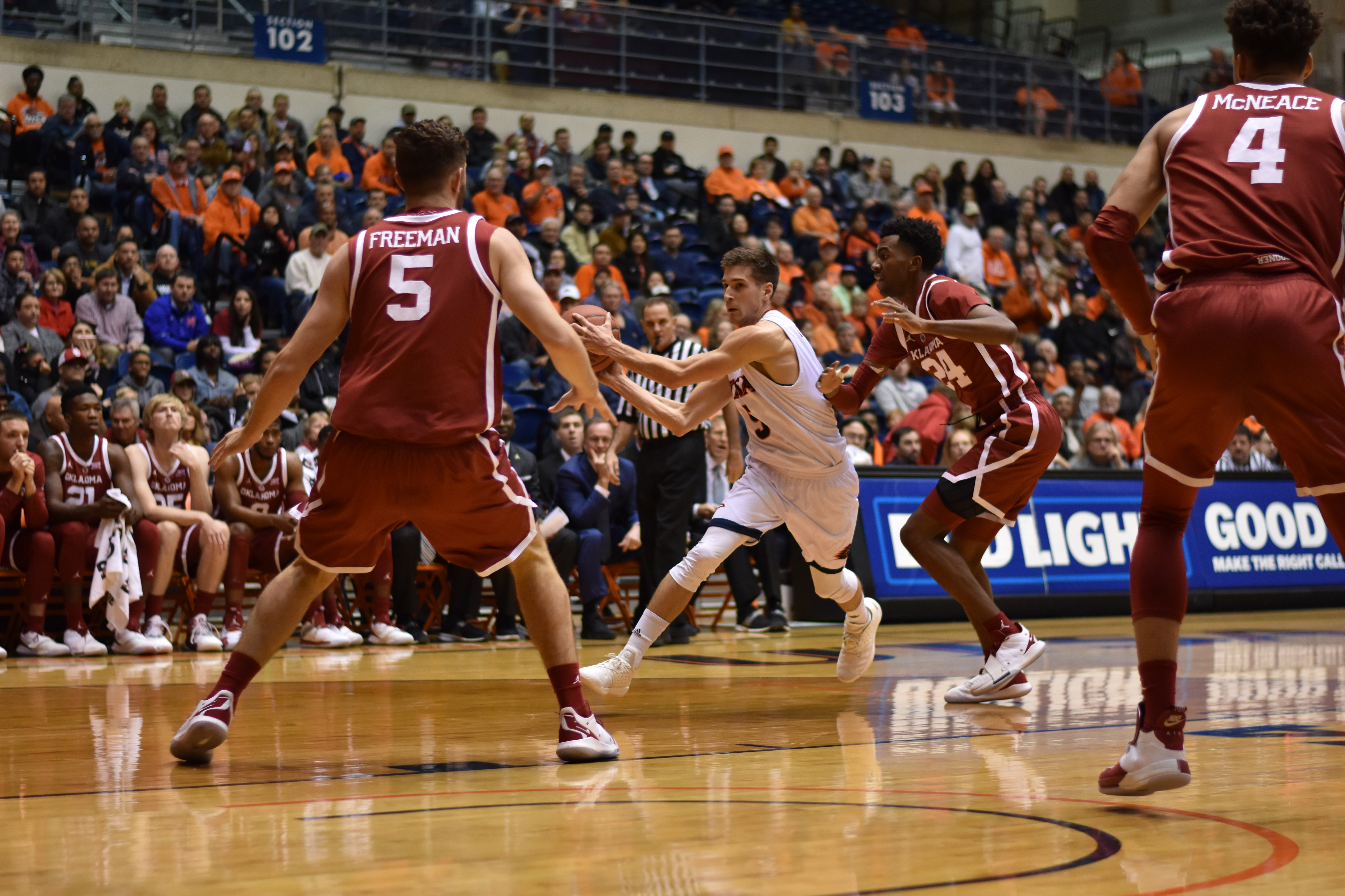 Guard Giovanni De Nicolao dribbles past some Oklahoma Sooners on his way to the rim.