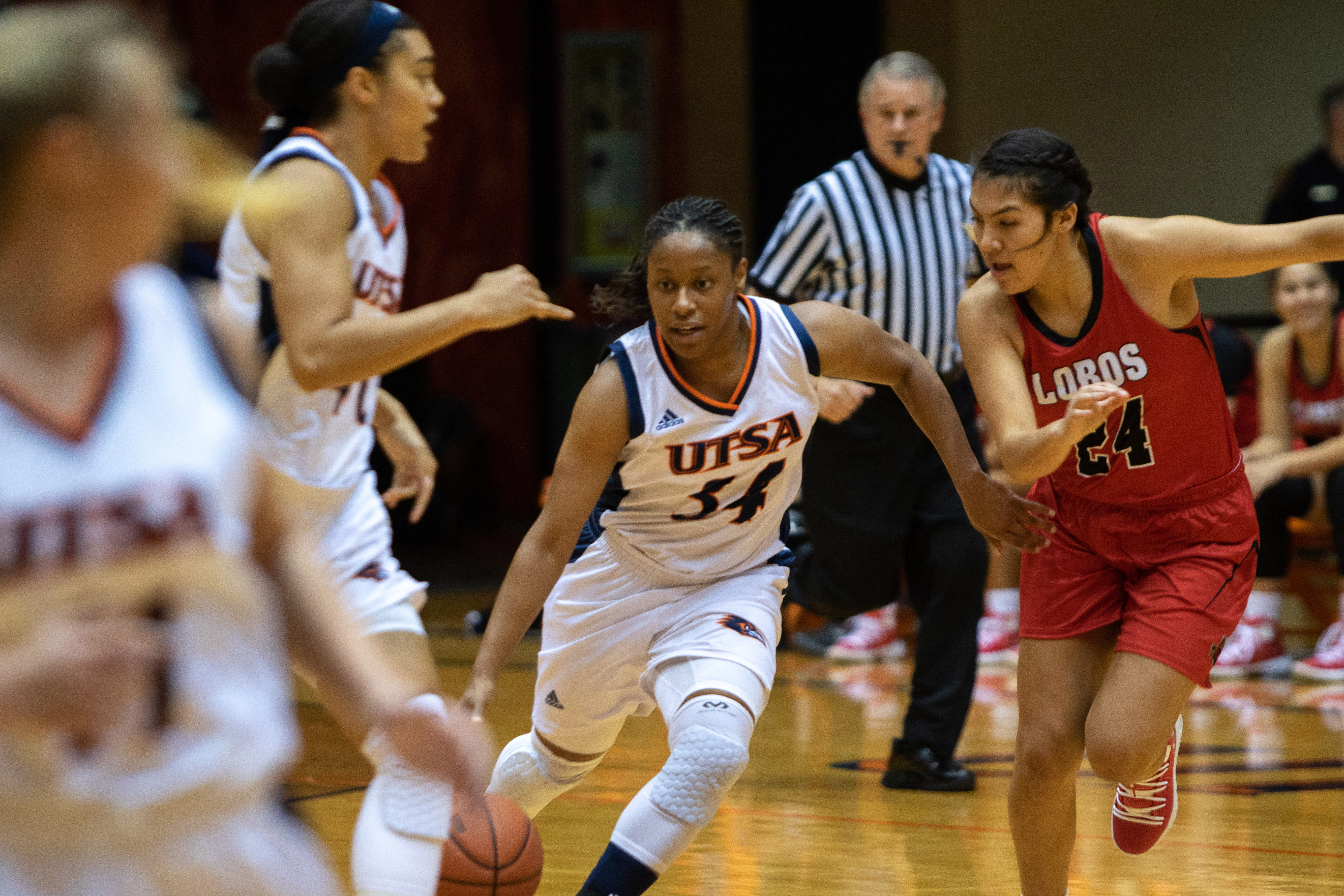 Guard Karrington Donald races her way past several defenders in a game against Sul Ross State.