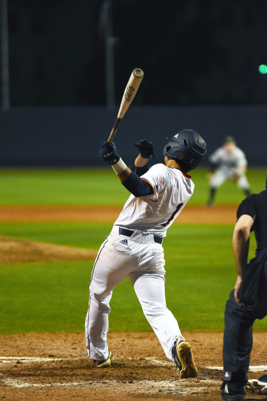 Jonathan Tapia hits the ball.