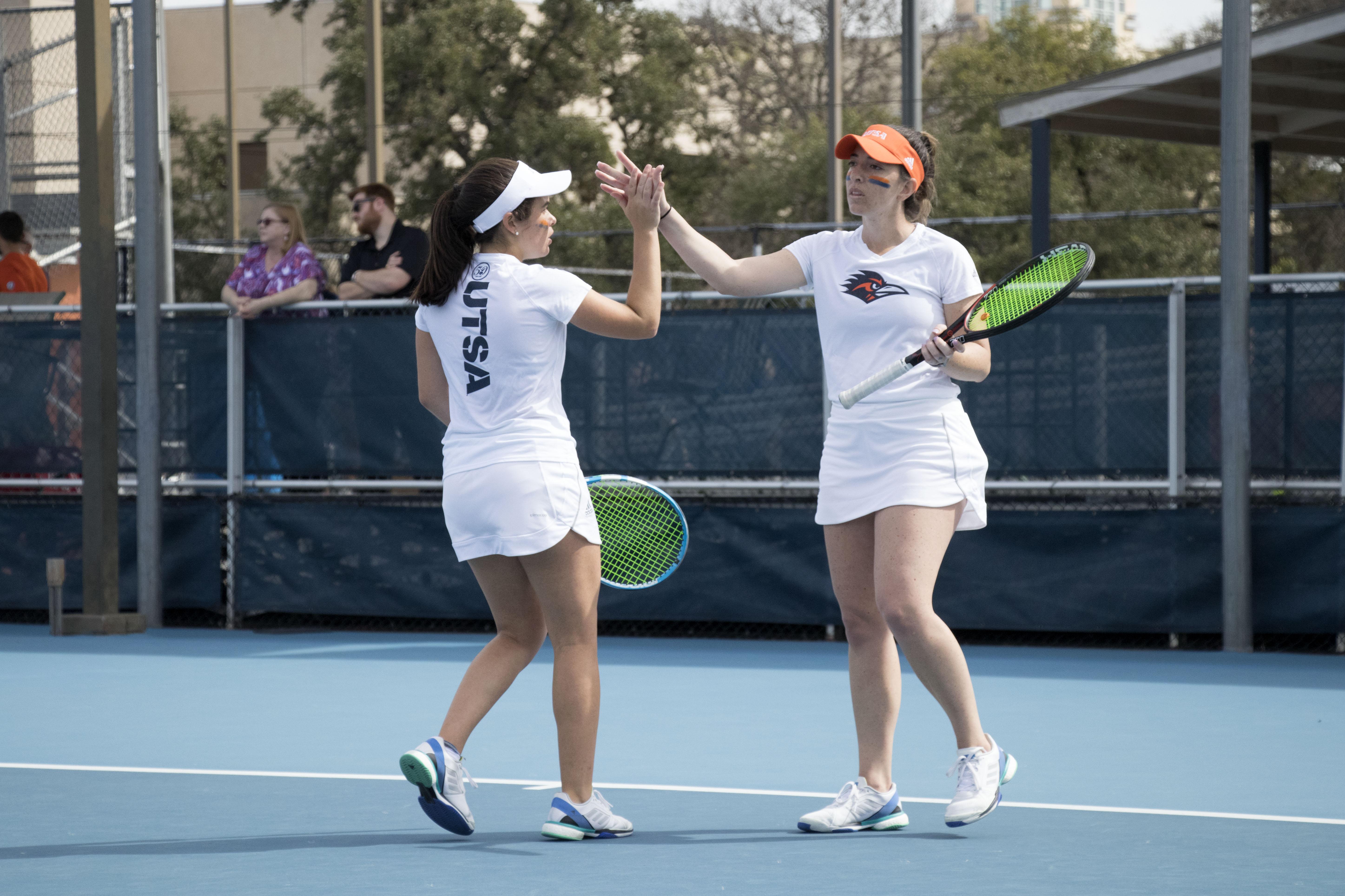 Mariah Plauth high-fives her teammate.