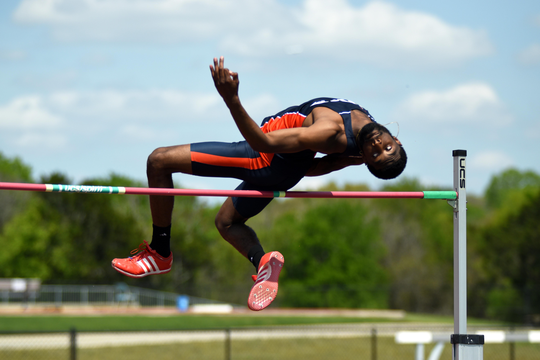 Davante Edwards leaps over the pole.