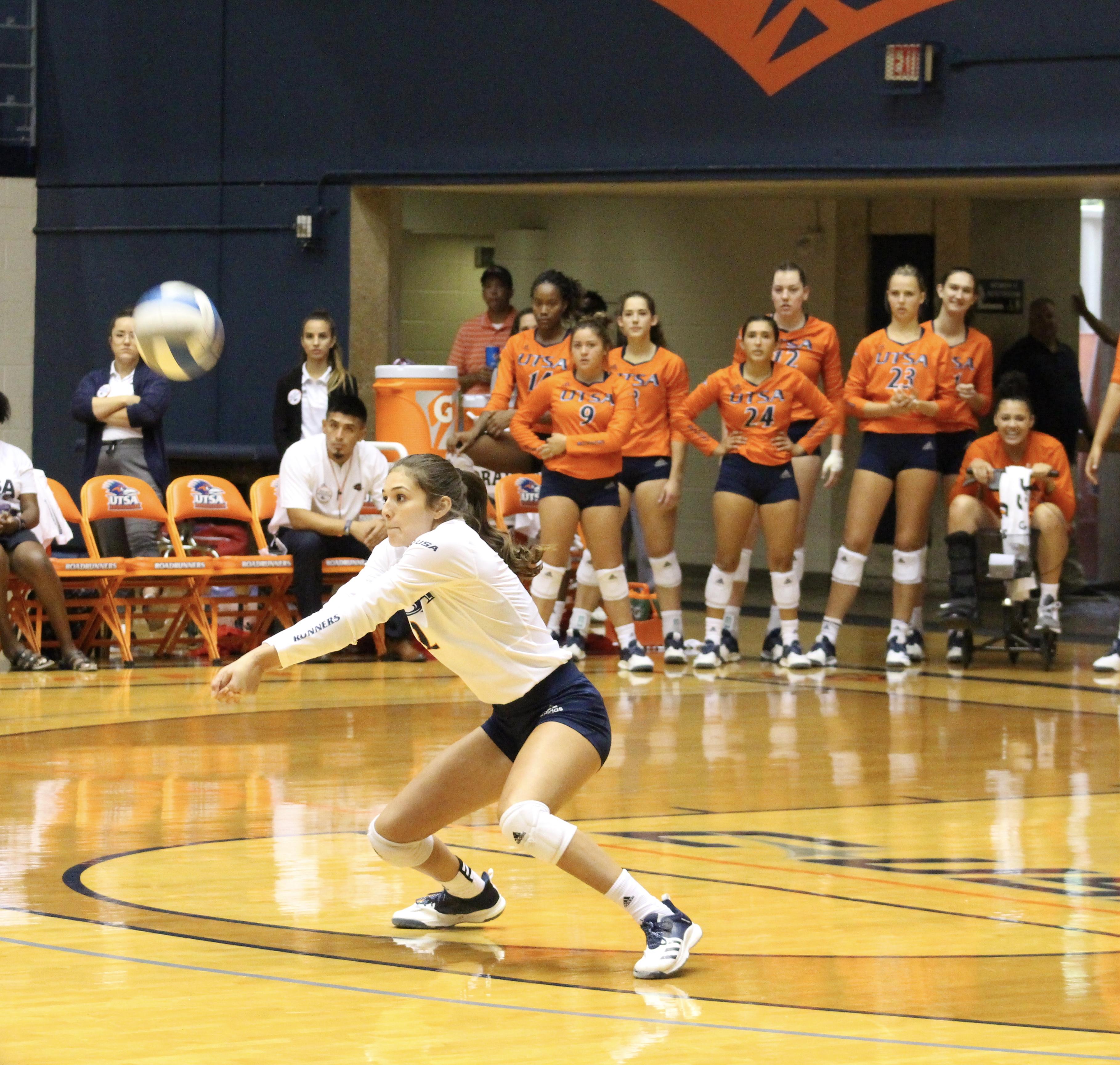 Emily Ramirez passing the ball to the setter. Photo by Julia Maeinus