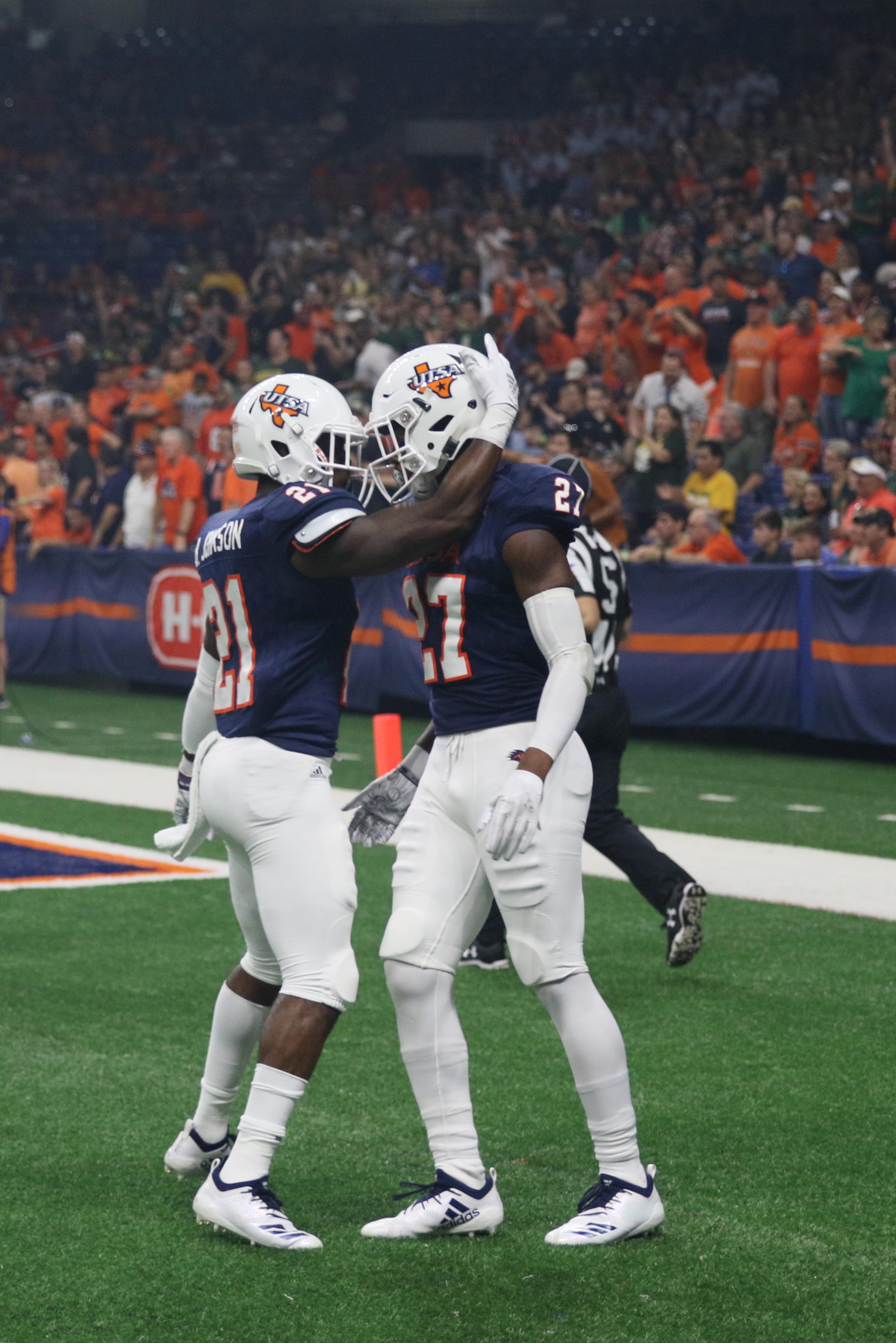 Brenndan Johnson and Teddrick McGhee celebrate a touchdown. Photo by Lindsey Thomas